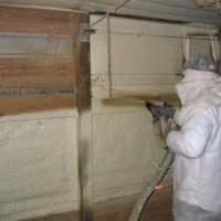 spraying urethane in a chicken house