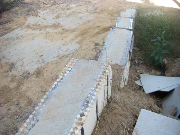 Arxx icf insulated concrete form foam moisture barrier for Foam block wall construction